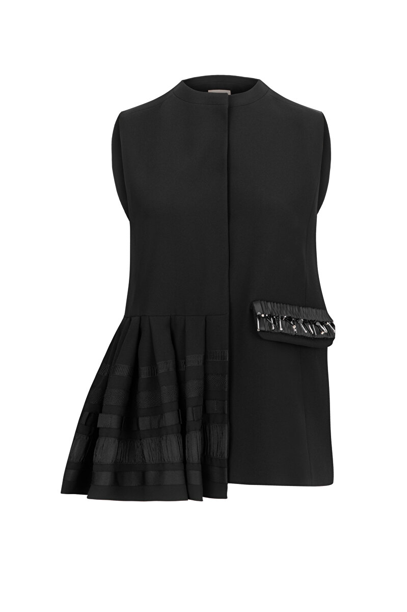 ASYMMETRICAL FLARED CREPE VEST WITH EMBROIDERED POCKET